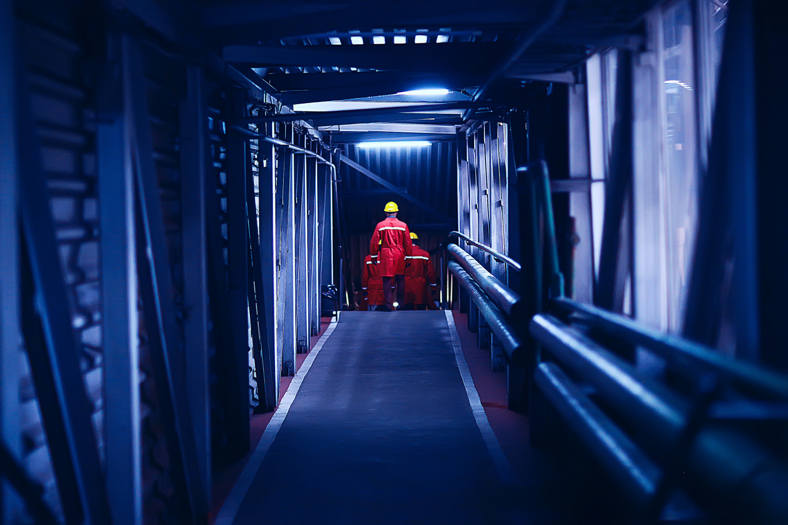 Men on offshore oil platform in a tunnel